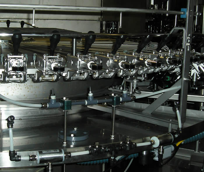 TAKK Inline Ionizer in a bottling application